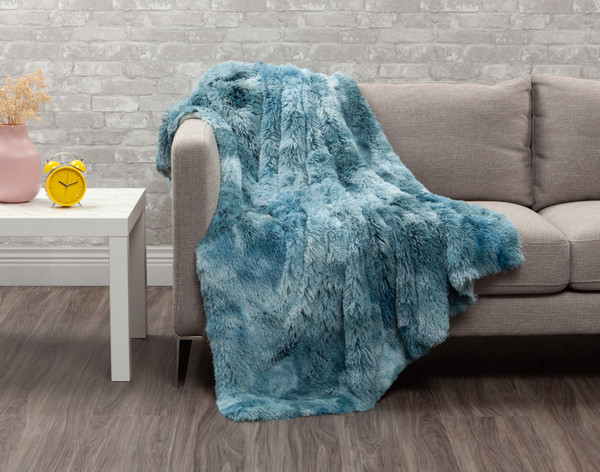 Our Frosted Shaggy Throw in Ocean, a marbled blue.