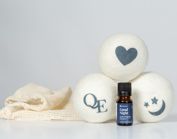 Linen Love Wool Dryer Balls and Good Night scent booster stacked together