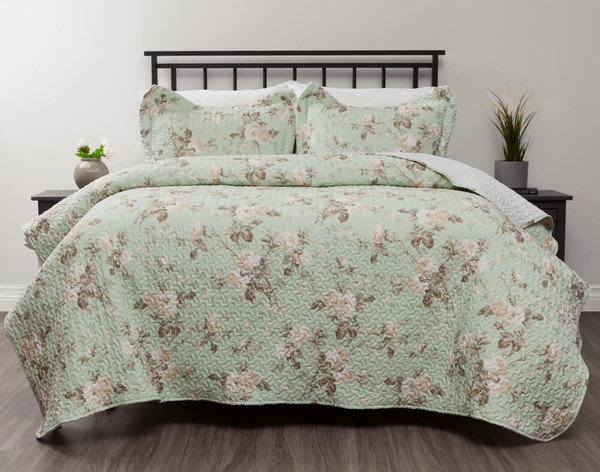 Gable Coverlet Set, featuring aclassic floral print in shades of cream and tan on a seafoam green background.
