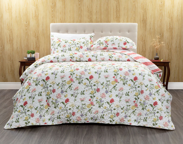 Windermere Coverlet Set featuresdelicate blooms in shades of red, yellow, pink, and purple on a white background.