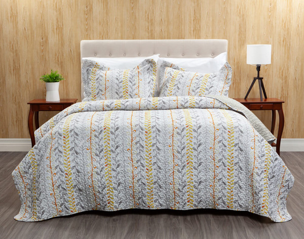Leno Coverlet Set, featuring amber, yellow, and grey botanicals arranged in a stripe formation across a white background