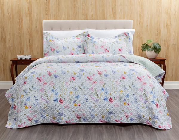 Larkfield features pink, blue, and yellow blooms on a white background.