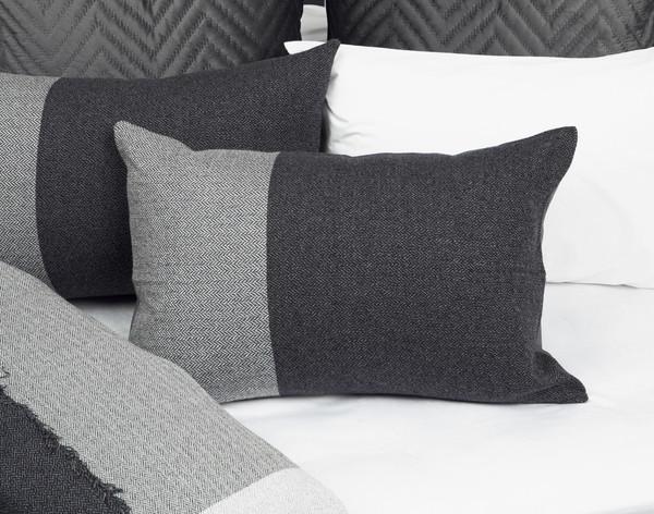 Thoren Pillow Sham laying on half-open Thoren bedding.