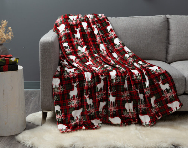 Festive Plaid Holiday Throw draped over a modern couch.