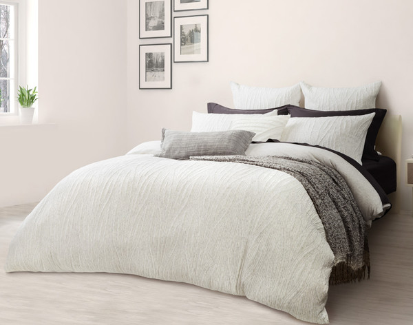 Side view of the Everley Bedding Collection, featuring Duvet Cover, Pillow Shams, and Euro Shams
