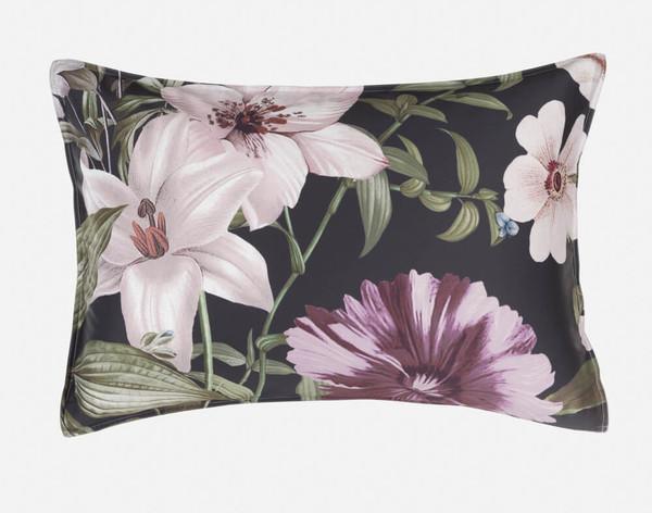 Close-up of Greta Floral Pillow Shams with light trim.