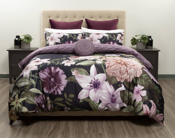 Our Greta Floral Bedding Collection features dark purples and rainforest greens on a deep black background.