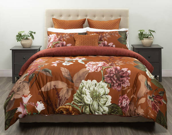Lillith Duvet Cover features pink and white peonies on a rich Amber background.