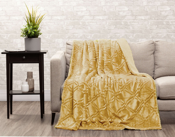 Gold Diamond Etched Throw draped over a couch