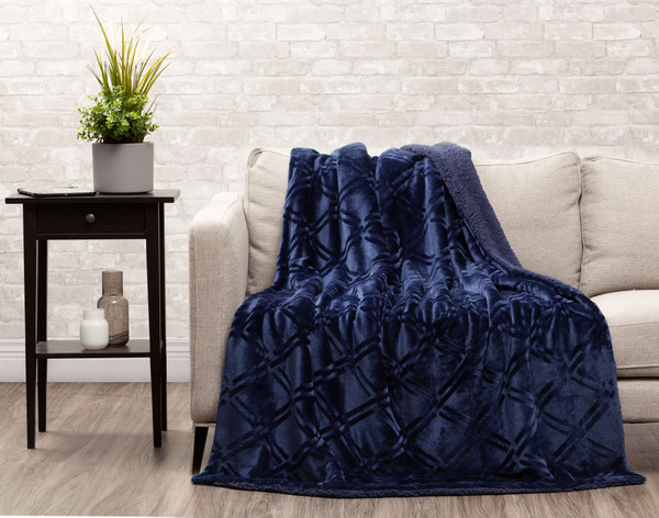 Indigo Diamond Etched Throw draped over a couch