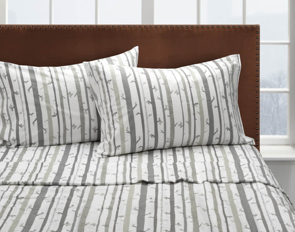 Front view of our Snowtrees Flannel Cotton Sheet Set dressed over a bed.