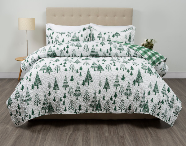 Treetops Coverlet Set, featuring vibrant forest green trees with a solid white background.