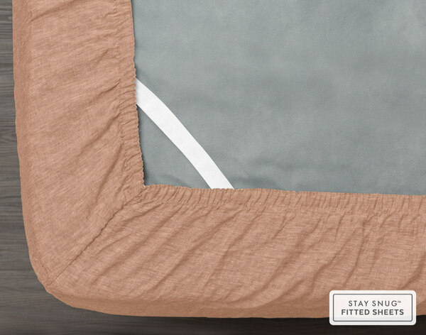 Vintage Washed European Linen Fitted Sheet in Clay, elastic view.