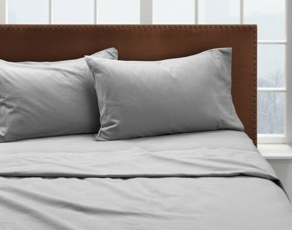 Our Moonstone Flannel Sheet Set dressed over a bed and pair of pillows.