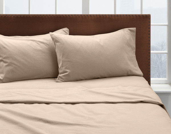 Our Putty Flannel Sheet Set dressed over a bed and pair of pillows.