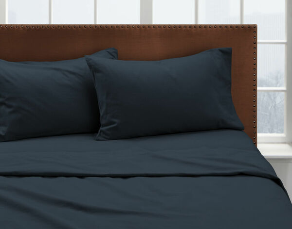 Our Sea Storm Flannel Sheet Set dressed over a bed and pair of pillows.