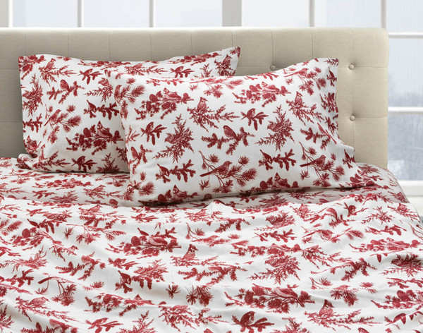 Our Avian Toile Flannel Sheet Set dressed over a bed and pair of pillows.