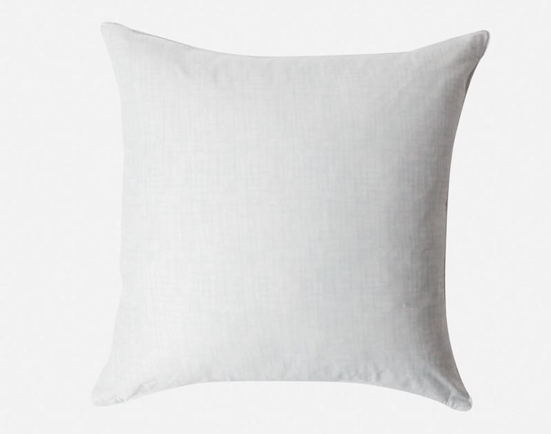 Hazelwood Euro Shams feature a light blue and white crosshatch print.