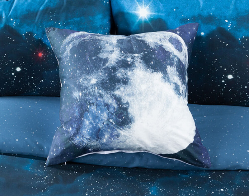 Supernova Square Cushion Cover on bed