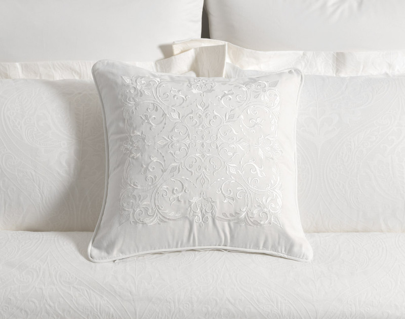 Astoria Square Cushion Cover on bed