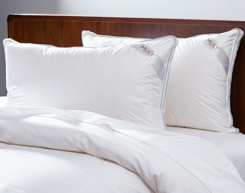 MLILY® Adjust-A-Pillow Memory Foam Pillow, upright on white bed.