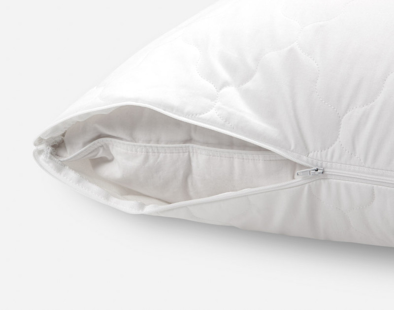 Quilted Pillow Protector unzipped to show inner pillow.