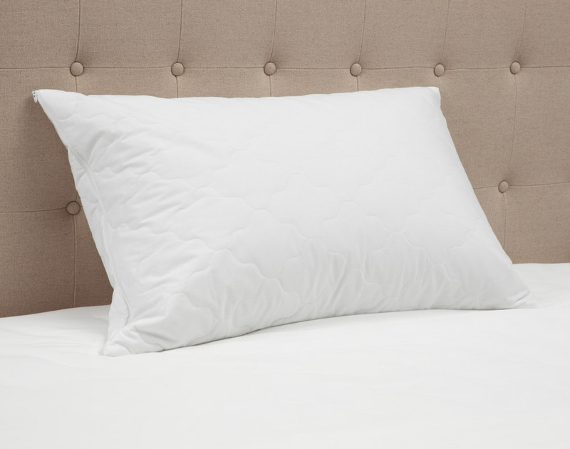 Quilted Pillow Protector on bed.