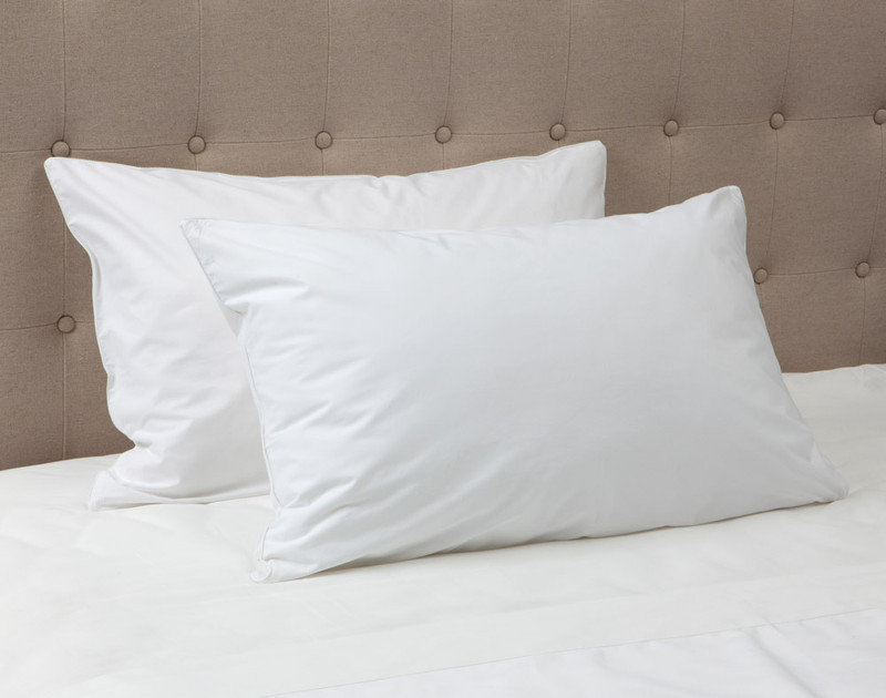 Elite Pillow Protector on bed.