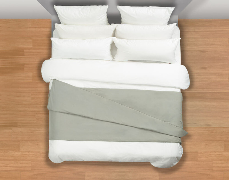 Balance Weighted Blanket with cotton cover at the foot of a bed