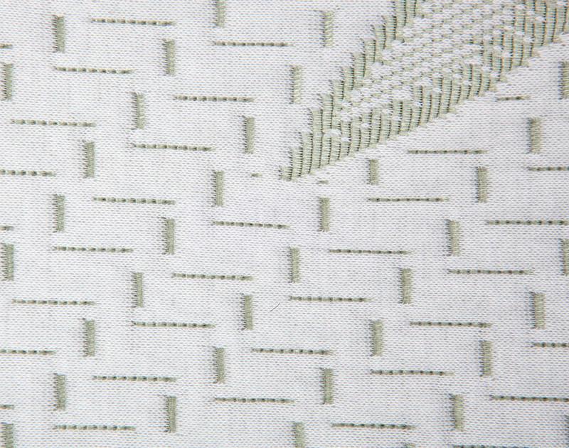 MLILY® Bamboo Charcoal Memory Foam Pillow logo stiching, close-up.