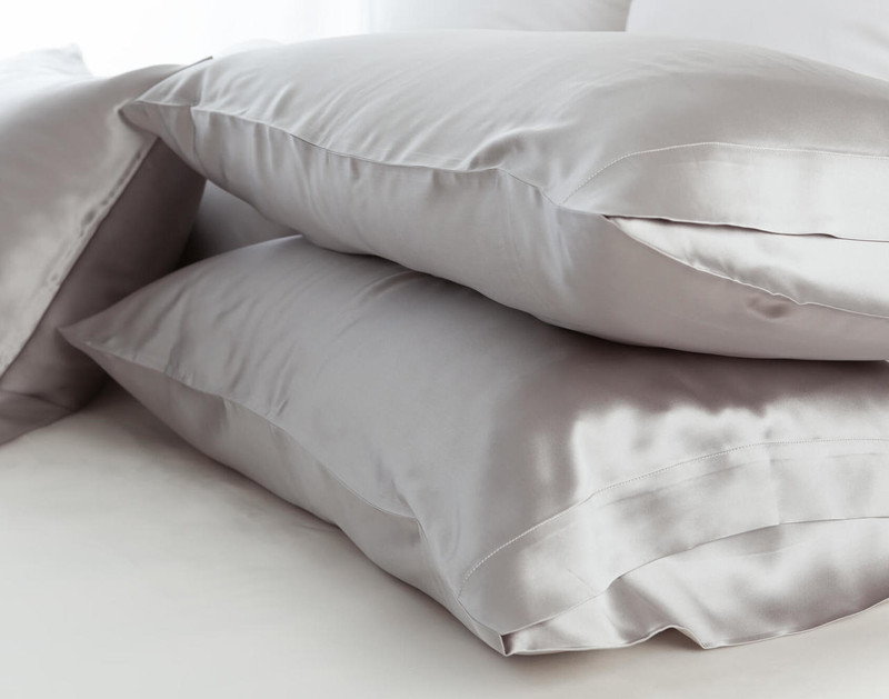 100% Mulberry Silk Pillowcases in Silver stacked.