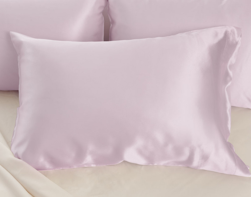 100% Mulberry Silk Pillowcase in Lavender Purple on bed.