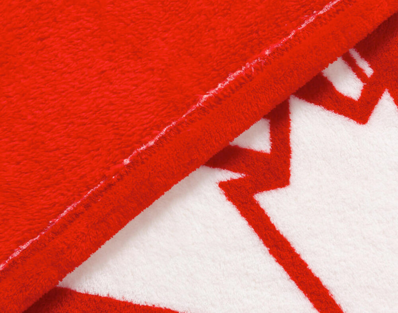 Half and half close-up view of Canoe Canada Fleece Throw front and reverse.