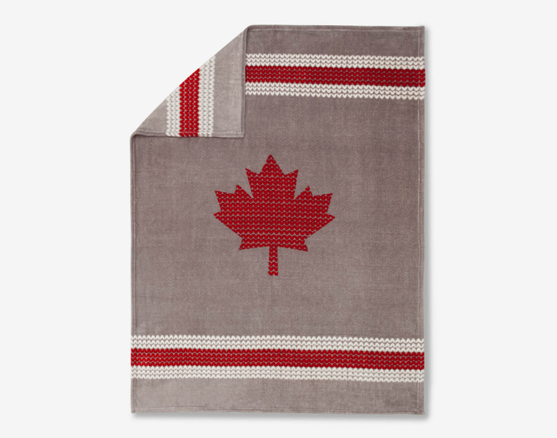Design of Chalet Sock Canada Fleece depicts a bright red maple leaf in the center on a grey background with red and white borders.