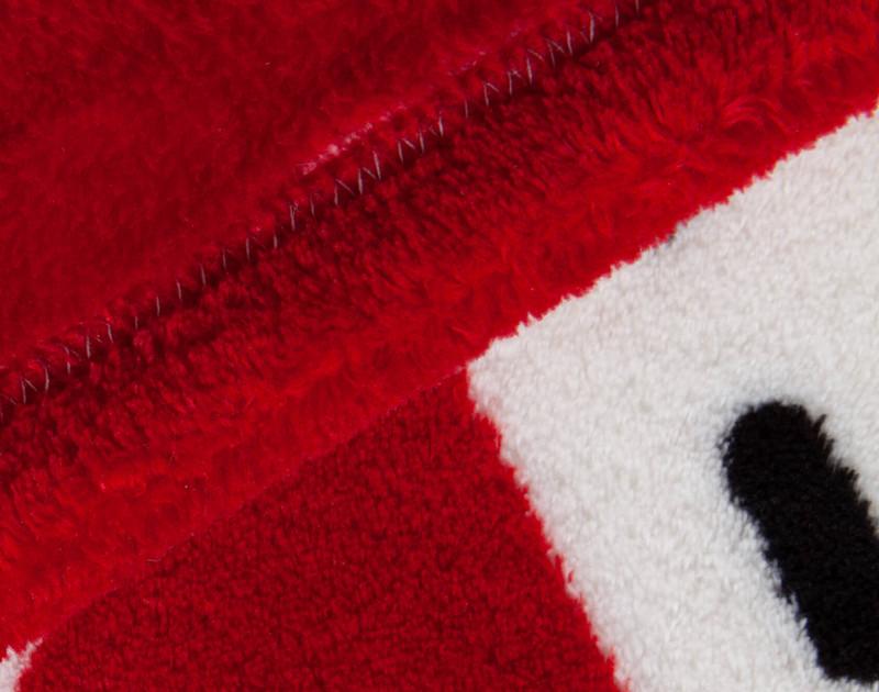 Close-up view of corner of Canada Fleece Throw.