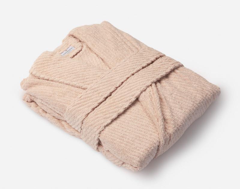 Blush Cotton Bathrobe folded, side view.
