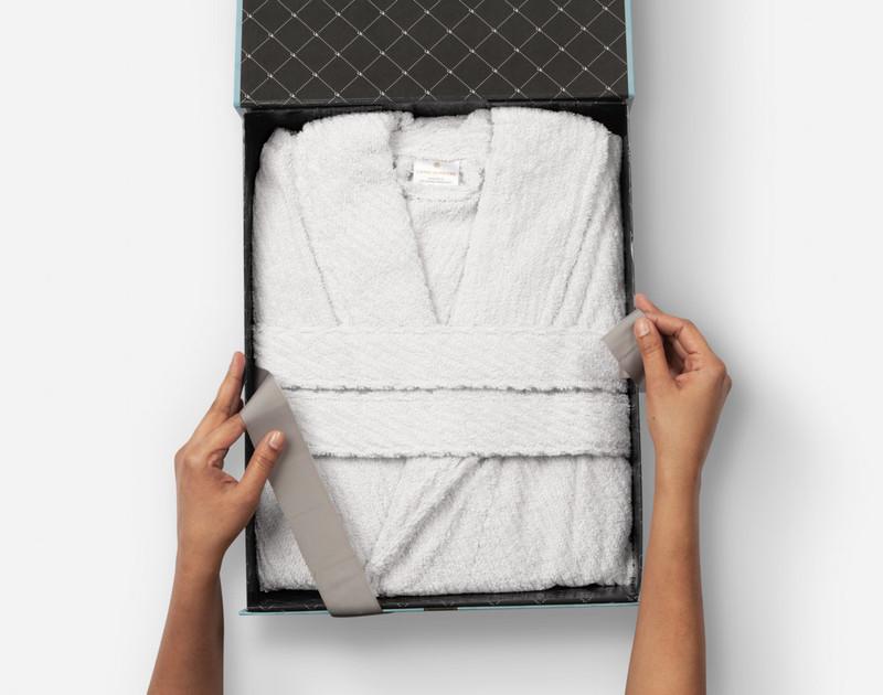 Cotton Bathrobe in White, nestled in a gift box.