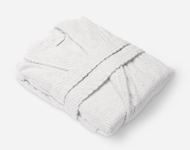 White Cotton Bathrobe folded, side view.