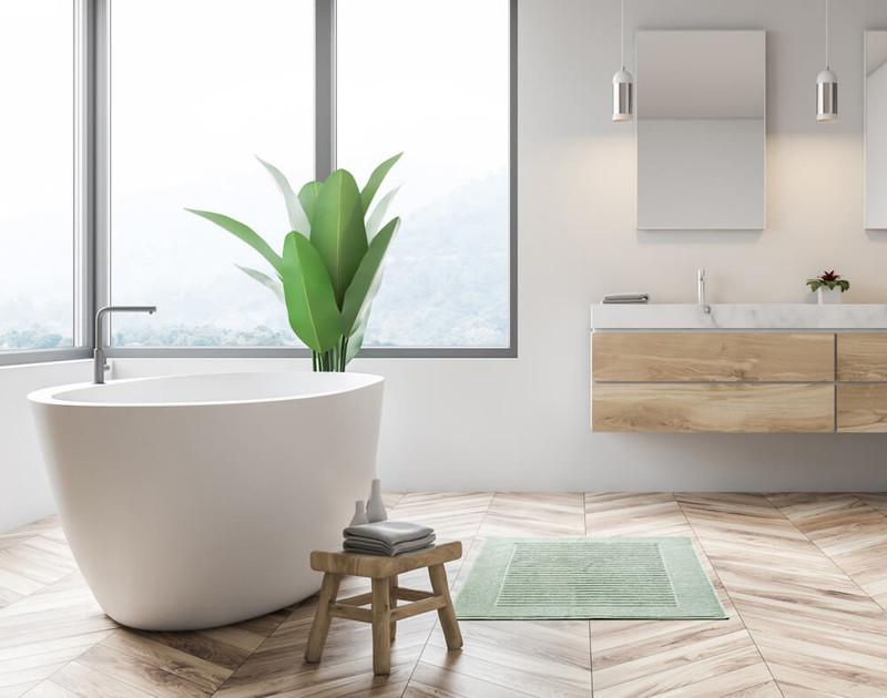 Modal Bath Mat in front of a modern white bathtub.