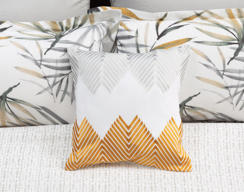 Tobago Square Cushion on bed
