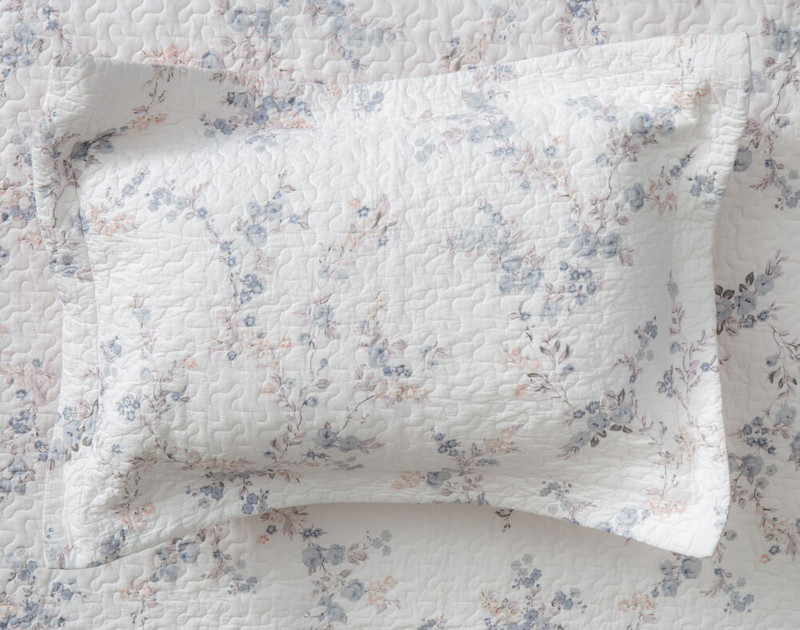 The Annalise Cotton Quilt Set Pillow Sham comes with a white cotton shell and delightful botanical print.