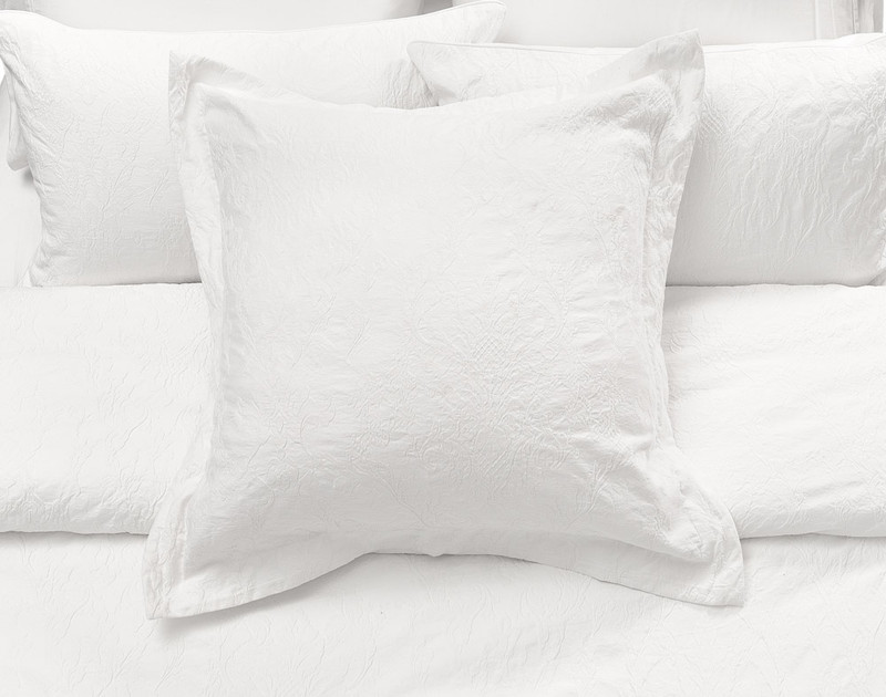 The Palma Duvet Cover Euro Sham on bed.