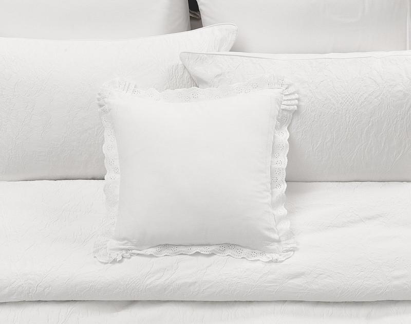 The Palma Duvet Cover Square Cushion Sham on bed.
