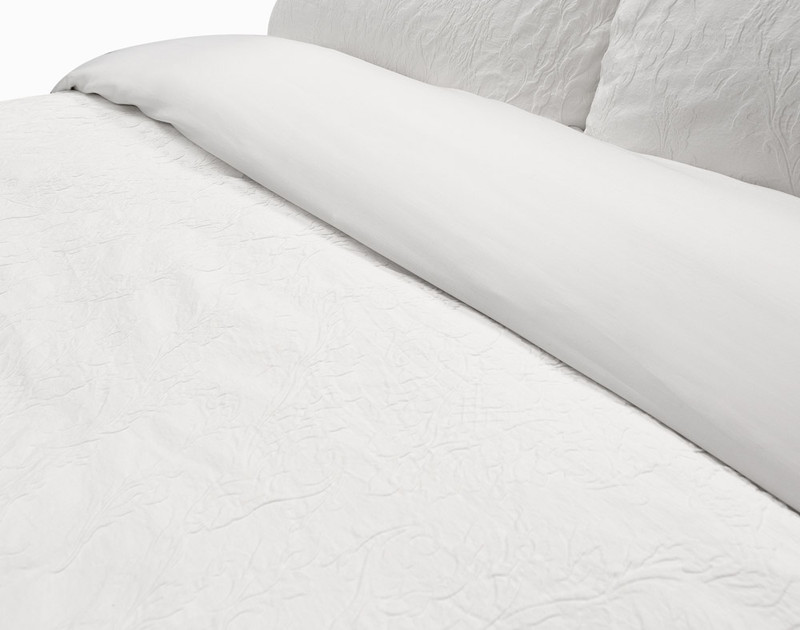 The Palma Duvet cover reverses to a white 300 Thread Count 100% cotton sateen.