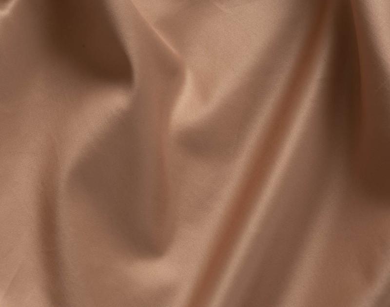 Close up of brushwood gold coloured Supima cotton.