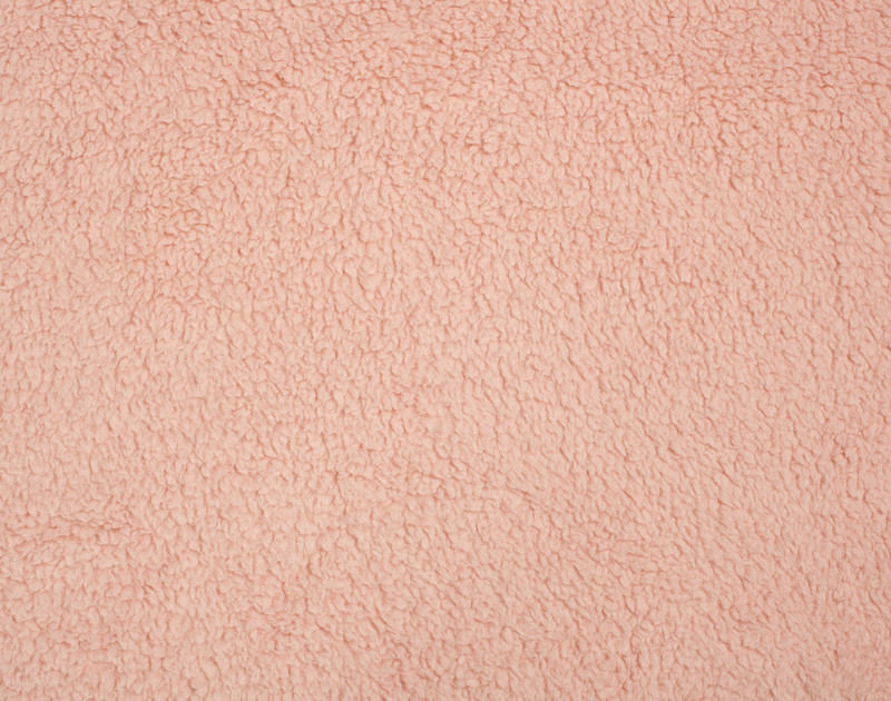 Close-up view of Teddy Throw in Dusty Peach.