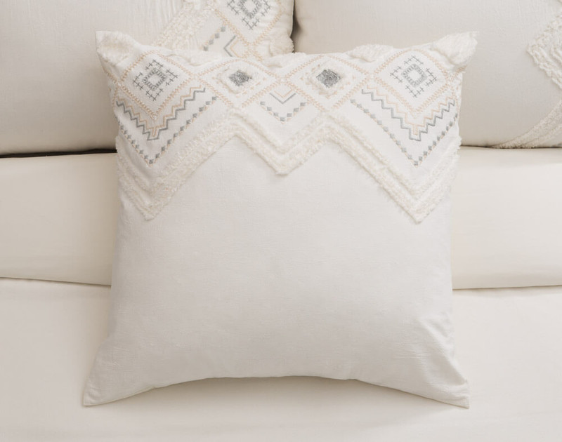 The Charity Euro Sham features geometric embroidery and chenille tufting.