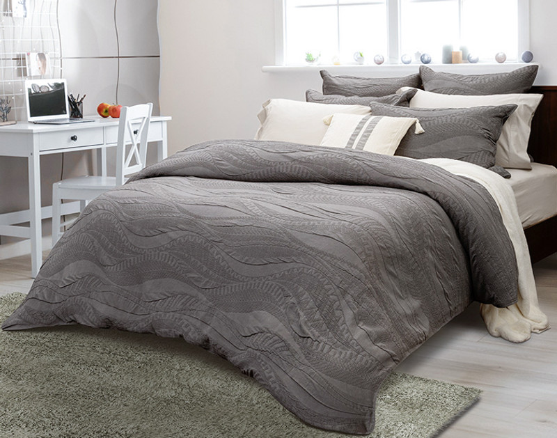 Side view; Noa is a stonewashed collection in shades of charcoal grey, with waves rippling across its surface.