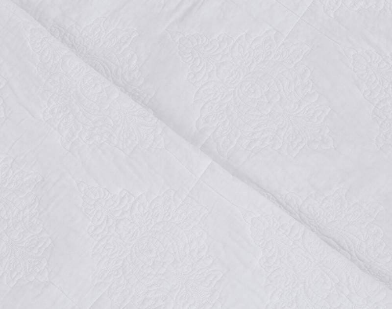 Close up of Marissa Cotton Quilt Set, a white damask pattern.