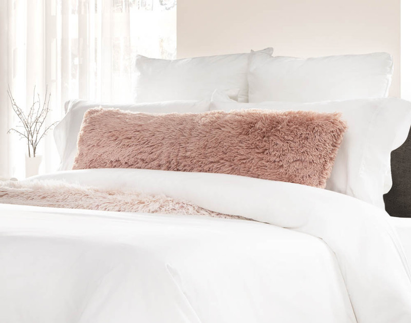 Frosty Lumbar Pillow in Camellia, a soft pink.